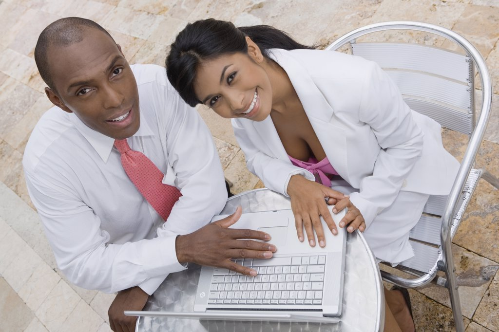 Stock Photo: 1589R-56054 Hispanic couple with laptop at cafe