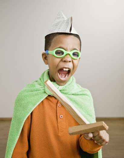 Stock Photo: 1589R-56455 Mixed Race boy playing dress-up