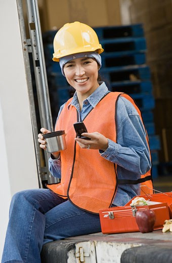 Stock Photo: 1589R-56557 Hispanic warehouse worker eating lunch
