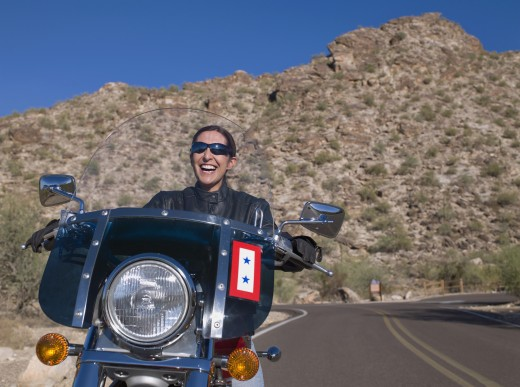 Stock Photo: 1589R-56700 Hispanic woman riding motorcycle