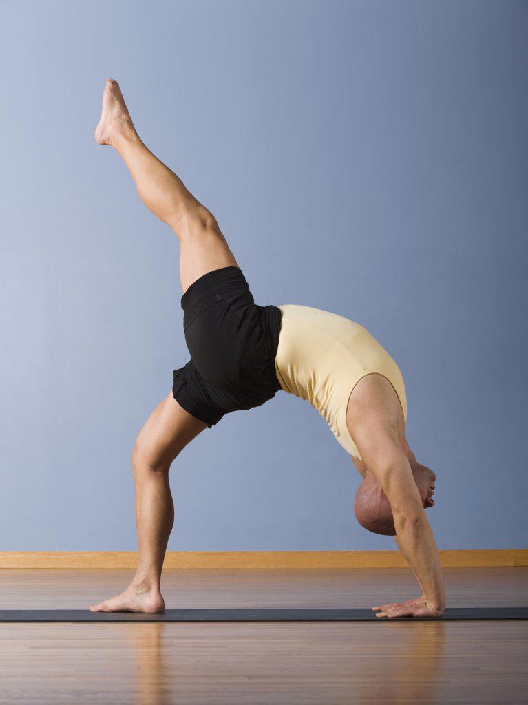 Stock Photo: 1589R-56930 Hispanic man practicing yoga