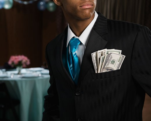 Stock Photo: 1589R-56969 African teenager with money in suit jacket pocket
