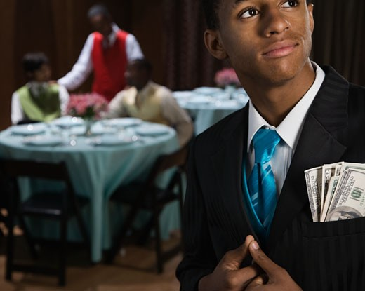 Stock Photo: 1589R-56970 African teenager with money in suit jacket pocket