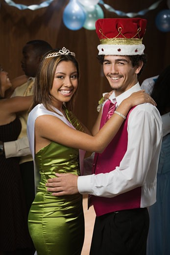 Stock Photo: 1589R-57017 Multi-ethnic prom king and queen dancing
