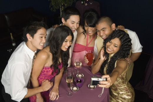 Multi-ethnic friends taking own photograph : Stock Photo