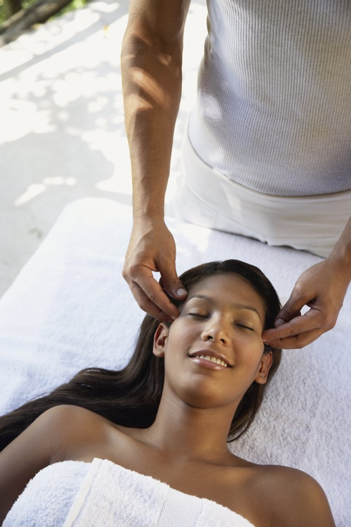 Stock Photo: 1589R-57340 Hispanic woman receiving facial massage