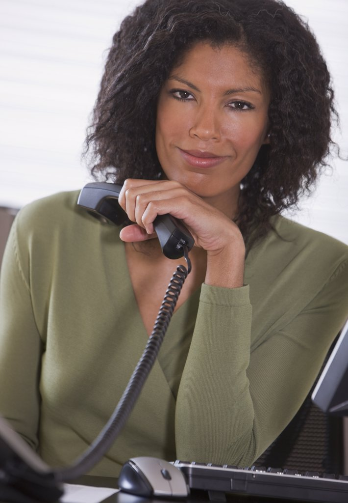 African businesswoman holding telephone : Stock Photo
