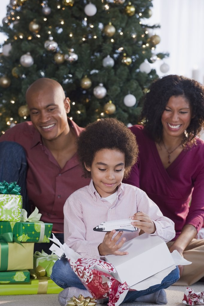 African family opening Christmas gifts : Stock Photo