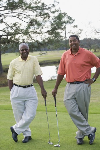 Stock Photo: 1589R-57542 African father and adult son on golf course