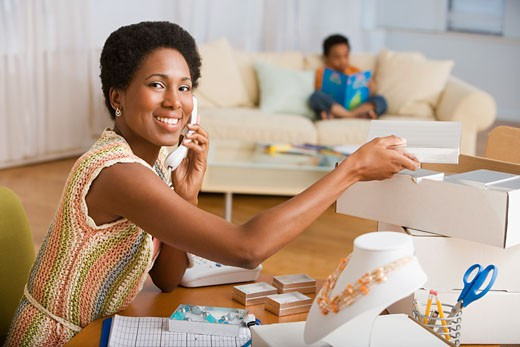Stock Photo: 1589R-57560 African woman making jewelry