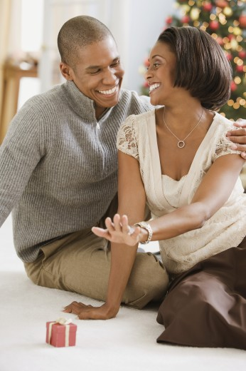 Mixed Race couple smiling at each other : Stock Photo