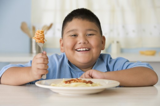 Hispanic boy eating spaghetti : Stock Photo