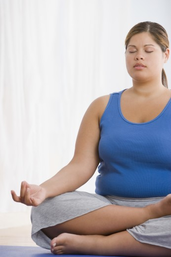 Stock Photo: 1589R-57755 Overweight Hispanic woman practicing yoga