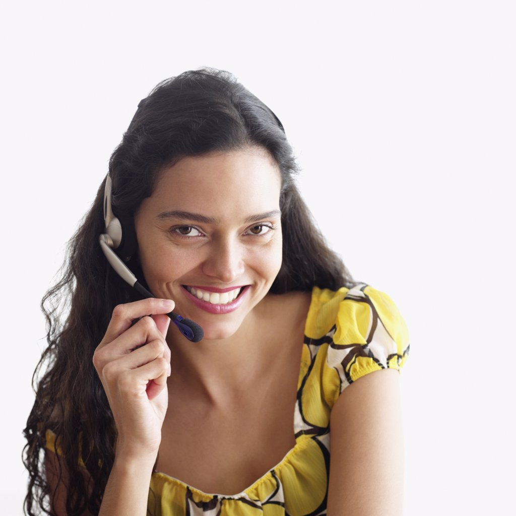 Hispanic woman wearing headset : Stock Photo