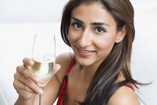 Stock Photo: 1589R-57903 Middle Eastern woman toasting with champagne