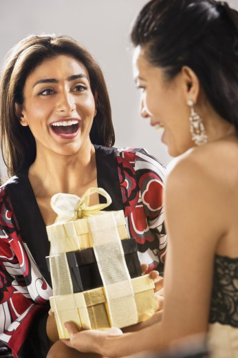 Middle Eastern woman receiving gift : Stock Photo