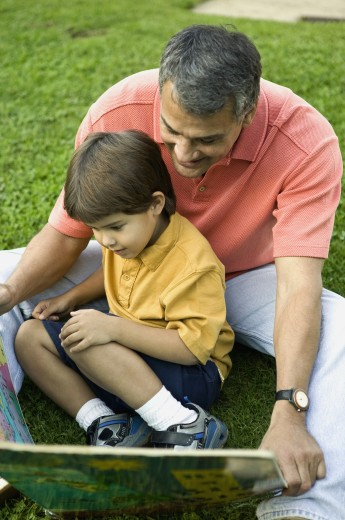 Stock Photo: 1589R-58027 Hispanic father and son looking at map