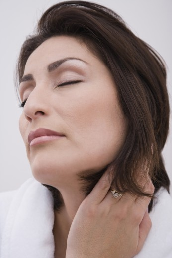 Stock Photo: 1589R-58056 Hispanic woman with eyes closed