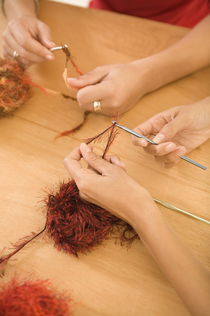 Stock Photo: 1589R-58285 Multi-ethnic women crocheting