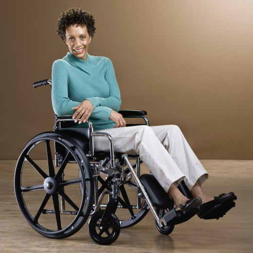 African woman in wheelchair : Stock Photo