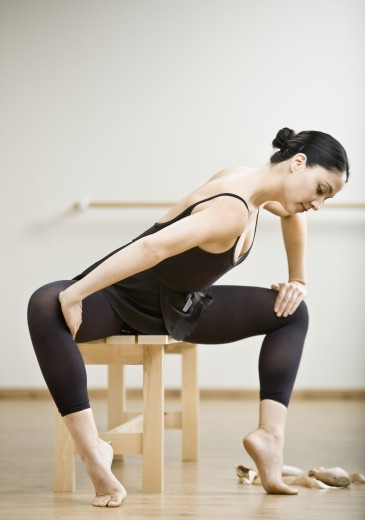 Stock Photo: 1589R-58597 Hispanic female dancer stretching