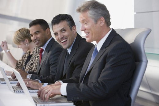 Stock Photo: 1589R-58685 Multi-ethnic businesspeople typing on laptops