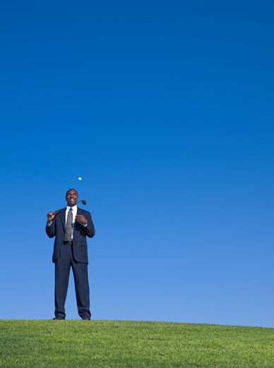 African businessman playing golf : Stock Photo
