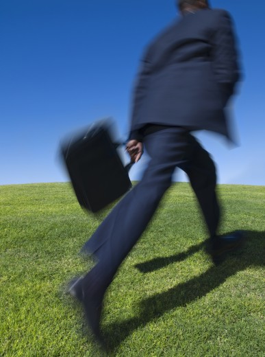 African businessman running uphill : Stock Photo
