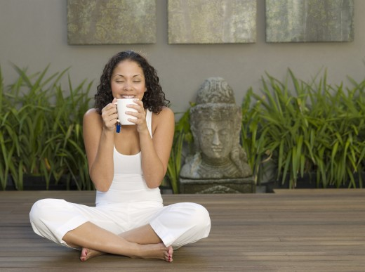 Stock Photo: 1589R-58842 Mixed Race woman drinking tea