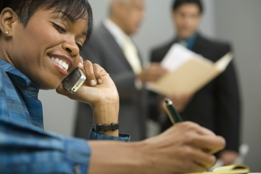 Stock Photo: 1589R-59021 African businesswoman talking on cell phone