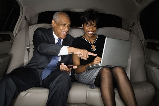 Stock Photo: 1589R-59029 African businesspeople looking at laptop