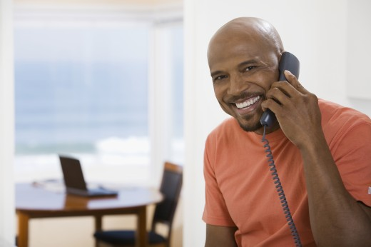 Stock Photo: 1589R-59143 African man talking on telephone