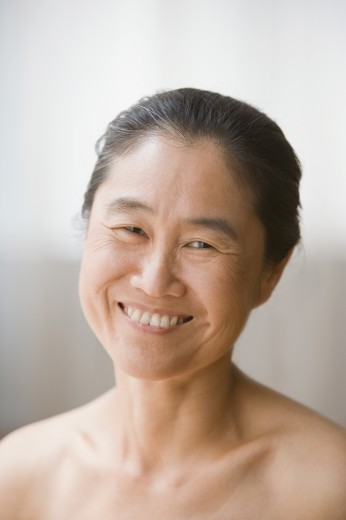 Stock Photo: 1589R-59381 Portrait of bare-shouldered Asian woman