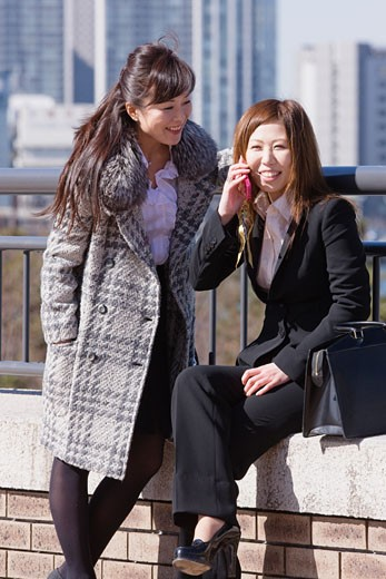 Stock Photo: 1589R-59540 Asian businesswomen outdoors
