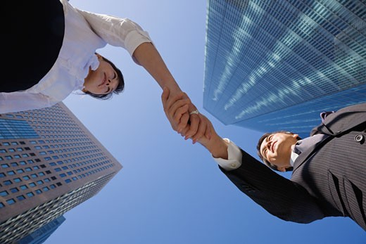 Asian businesspeople shaking hands : Stock Photo