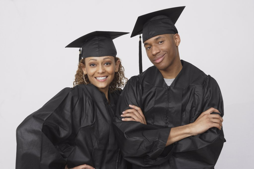 Stock Photo: 1589R-59632 African couple wearing graduation caps and gowns