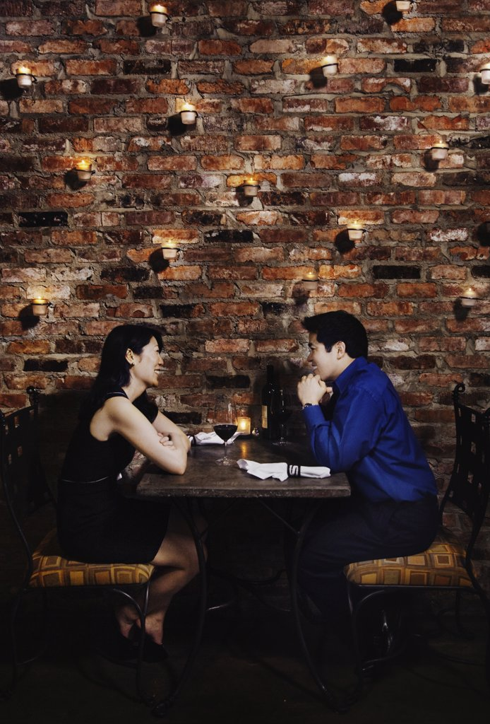 Stock Photo: 1589R-59776 Asian couple eating at restaurant