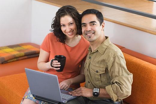 Hispanic couple with laptop : Stock Photo