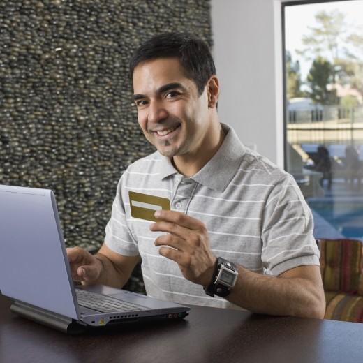 Stock Photo: 1589R-59924 Hispanic man shopping online