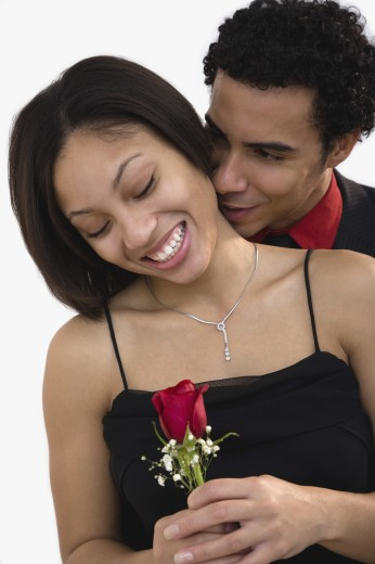 African couple hugging with rose : Stock Photo