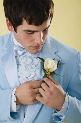 Stock Photo: 1589R-60005 Hispanic young man pinning boutonnière