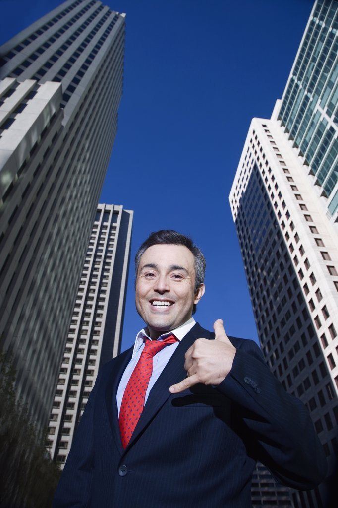 Hispanic businessman making hand gesture : Stock Photo