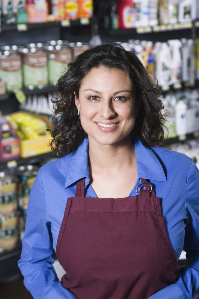 Hispanic sales clerk in hardware store : Stock Photo