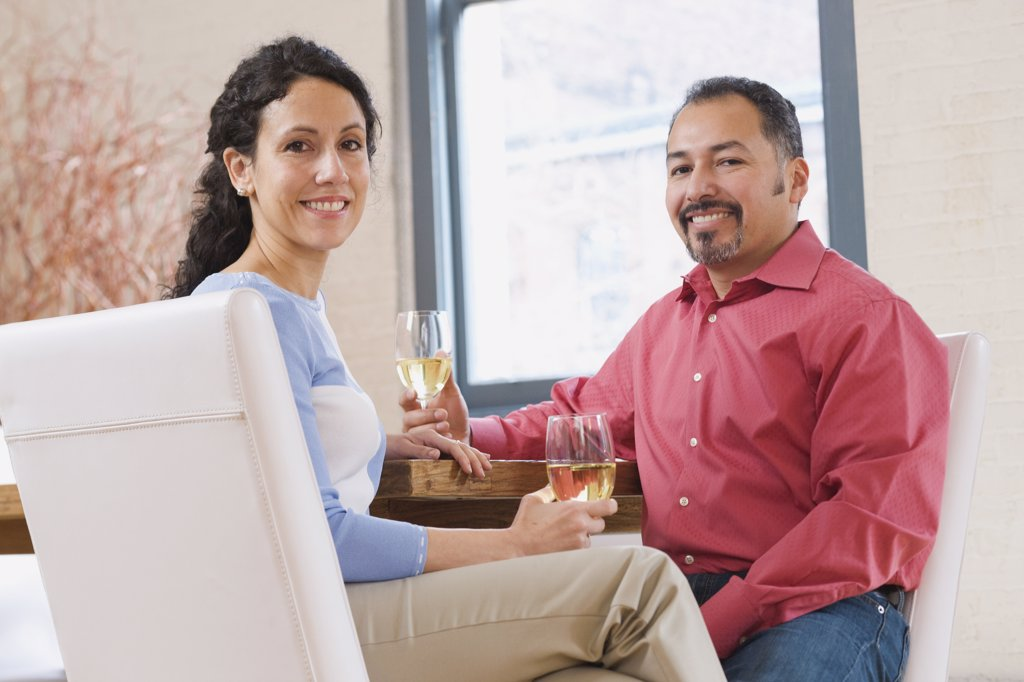 Stock Photo: 1589R-60139 Hispanic couple drinking wine