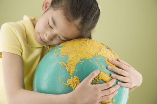 Stock Photo: 1589R-60289 Asian girl hugging globe
