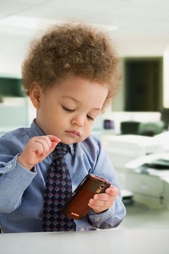 Mixed Race baby dressed like businessman : Stock Photo