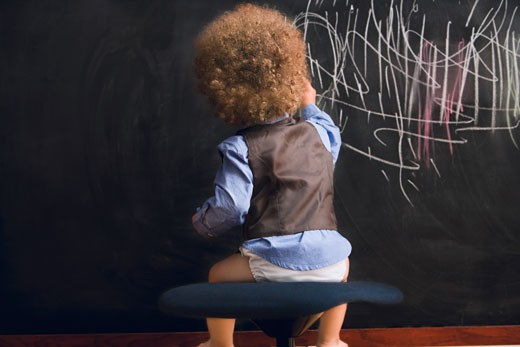 Stock Photo: 1589R-60710 Mixed Race baby writing on blackboard