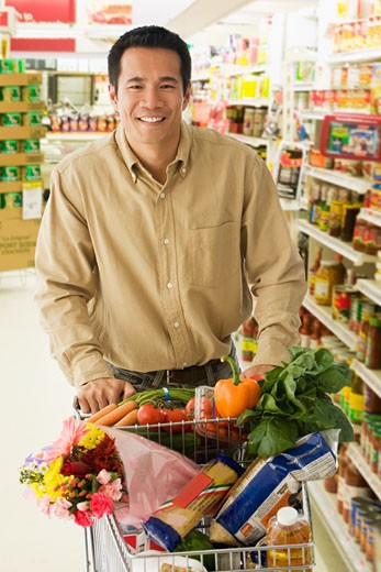 Asian man grocery shopping : Stock Photo