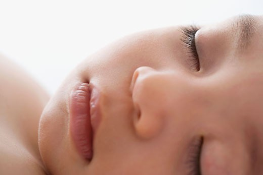 Close up of Hispanic baby sleeping : Stock Photo