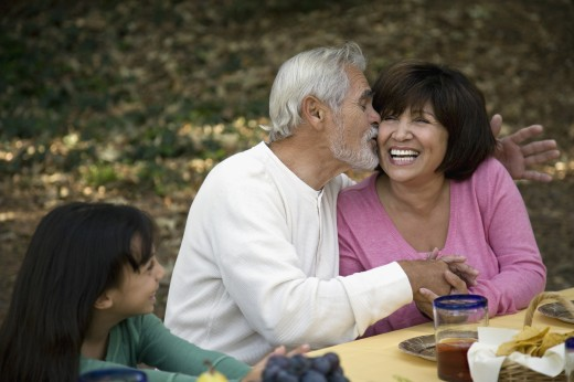 Stock Photo: 1589R-61017 Senior Hispanic man kissing wife